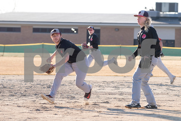 Sam Buckner for Shaw Media.<br /> Brendan Wortman fields a ground ball and prepares to throw to first base on Wednesday March 14, 2018.