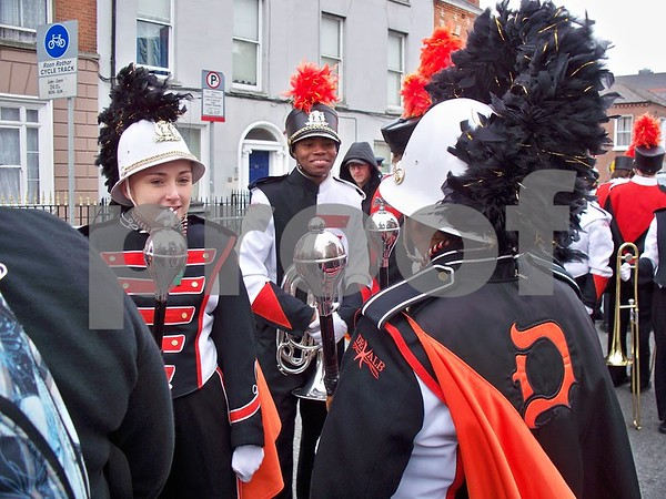Drum Major Madeline Hoth (left) and Ronell Chisom are all smiles as they anticipate step-off time.  Julie Spahn for Shaw Media