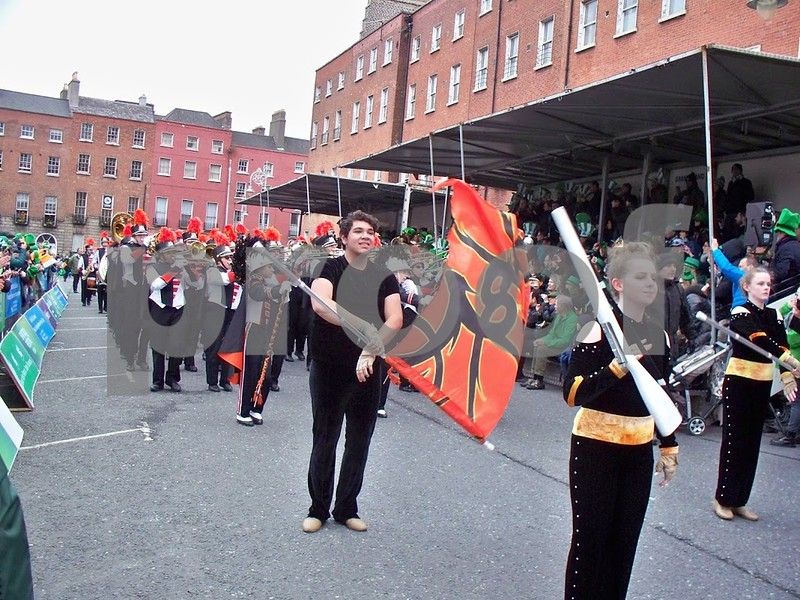 Members of the color guard lead the band past one of the viewing stages at Parnell Square North. Julie Spahn for Shaw Media