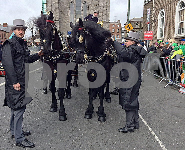 Footmen tend the mayor of Dublin's carriage before the parade.    Julie Spahn for Shaw Media