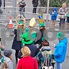 St. Patrick poses for a selfie with audience members as he heads to the start of the parade.  Julie Spahn for Shaw Media