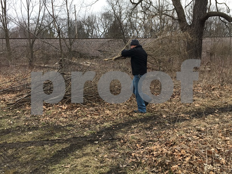 Frederick Robles volunteers Saturday during a cleanup of Prairie Park in DeKalb. The DeKalb Park District plans to have a project a month in the spring before skipping the summertime, and resuming in the fall.