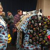 Attendees to the 2017 Railfest try on shirts with trains on them. (Betsy Scott/The News-Herald)