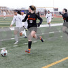 McKenna Wallin of DeKalb looks up the field Saturday, March 17, 2018 as she dribbles down the sidelines during their game against West Chicago.<br /> <br /> Sarah Minor - For Shaw Media