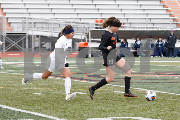 DeKalb captain Maddie Hill dribbles the ball Saturday, March 17, 2018 during their game against West Chicago in which she scored the only goal in the first half.<br /> <br /> Sarah Minor - For Shaw Media
