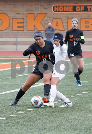 Litzy Murrieta of DeKalb tries to take control of the ball Saturday, March 17, 2018 during their game against West Chicago.<br /> <br /> Sarah Minor - For Shaw Media
