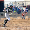 Sam Buckner for Shaw Media.<br /> Rock Falls Miranda Hewitt bunts and successfully reaches first base and scored an RBI on Monday March 20, 2017 against Genoa-Kingston High School.