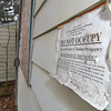 "Eric Bonzar - The Morning Journal<br /> A ""Do Not Occupy"" notification is stapled to the siding of a condemned duplex located at 419 Kentucky Ave., March 21, 2017. Similar signs are popping up on vacant homes in Lorain, Elyria and some areas of Sheffield Township as the Lorain County Land Reutilization Corp. looks to demolish more than 300 homes, using county-awarded funds."