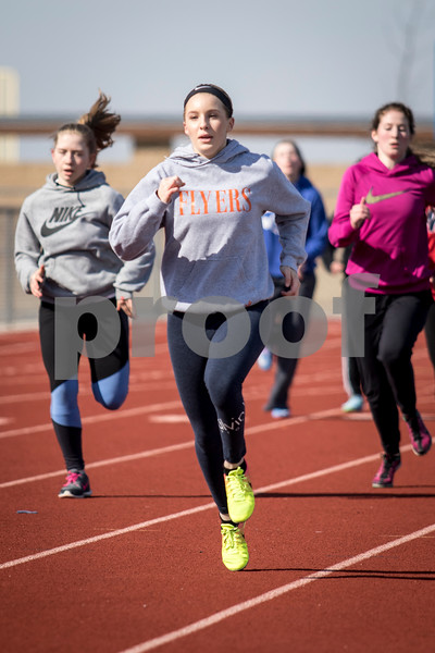 Sam Buckner for Shaw Media.<br /> Sierra Long runs a 200m sprint during practice on Wednesday March 22, 2017 along with her team mates.