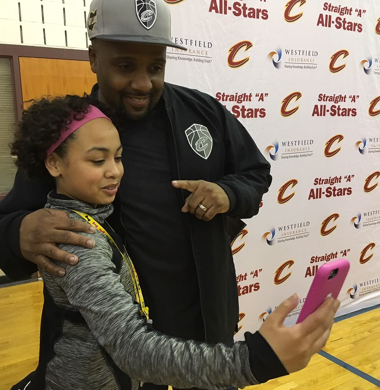 . Richard Payerchin - The Morning Journal <br> A scholar from Lorain City Schools\' General Johnnie Wilson Middle School poses for a selfie photo with Cleveland Cavaliers hype man Ahmaad Crump on March 22, 2018. Cavs representatives visited the school to present a $1,000 check for the Cavs\' Straight �A� All-Stars program, presented by Westfield Insurance.