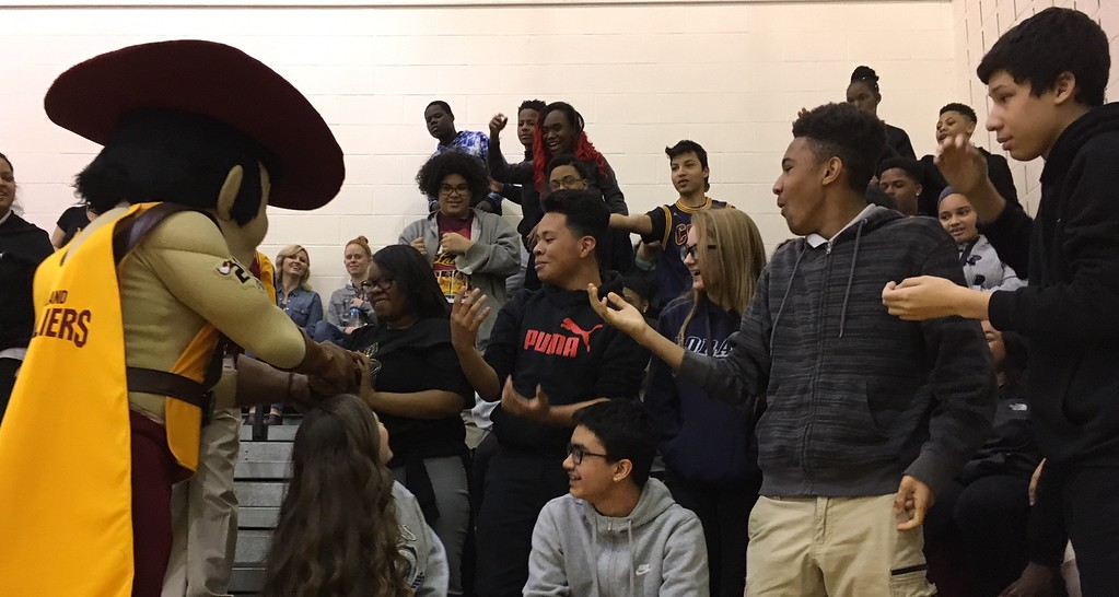 . Richard Payerchin - The Morning Journal <br> Cleveland Cavaliers mascot Sir C.C. presents a T-shirt to eighth-grader Oni Lawrence, 14, on March 22, 2018, at Lorain City Schools\' General Johnnie Wilson Middle School. Cavs representatives visited the school to present the $1,000 check for the Cavs\' Straight �A� All-Stars program, presented by Westfield Insurance.