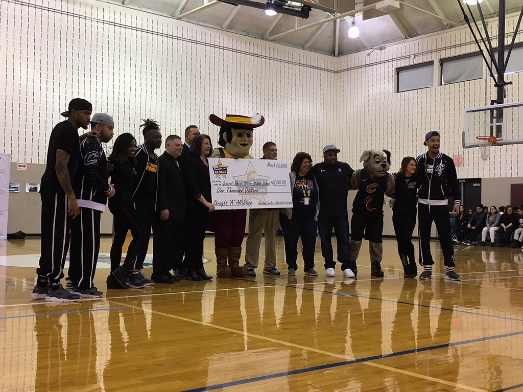 . Richard Payerchin - The Morning Journal <br> Staff and visitors at Lorain City Schools\' General Johnnie Wilson Middle School, pose for a photograph with a $1,000 check on March 22, 2018. Cavs representatives visited the school to present the $1,000 check for the Cavs\' Straight �A� All-Stars program, presented by Westfield Insurance.