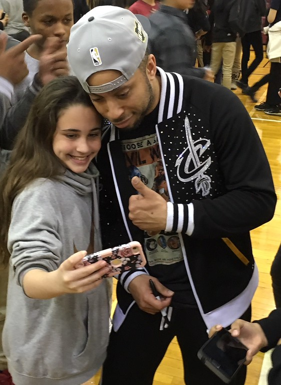 . Richard Payerchin - The Morning Journal <br> A scholar from Lorain City Schools\' General Johnnie Wilson Middle School poses for a selfie photo with a member of the Cleveland Cavaliers Scream Team on March 22, 2018. Cavs representatives visited the school to present a $1,000 check for the Cavs\' Straight �A� All-Stars program, presented by Westfield Insurance.