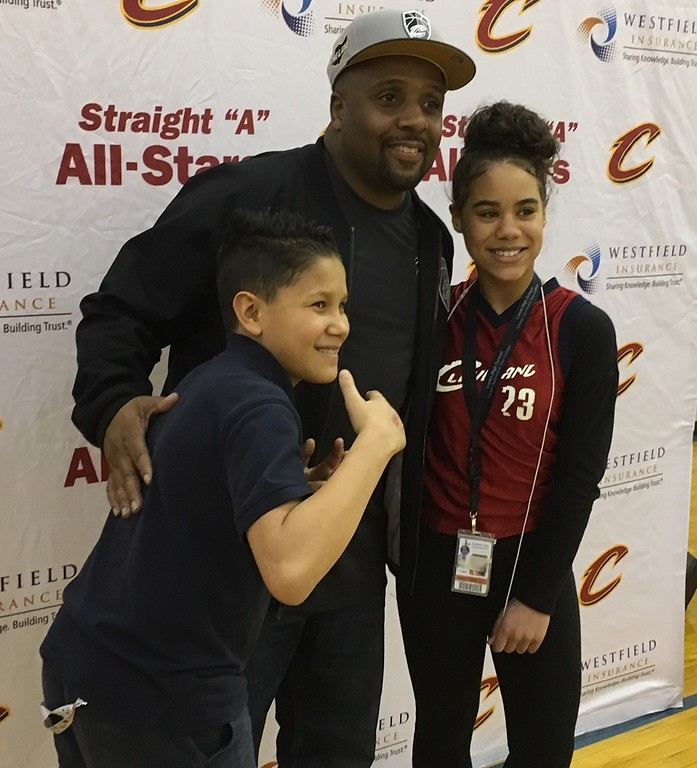 . Richard Payerchin - The Morning Journal <br> Scholars from Lorain City Schools\' General Johnnie Wilson Middle School pose for a photo with Cleveland Cavaliers hype man Ahmaad Crump on March 22, 2018. Cavs representatives visited the school to present a $1,000 check for the Cavs\' Straight �A� All-Stars program, presented by Westfield Insurance.