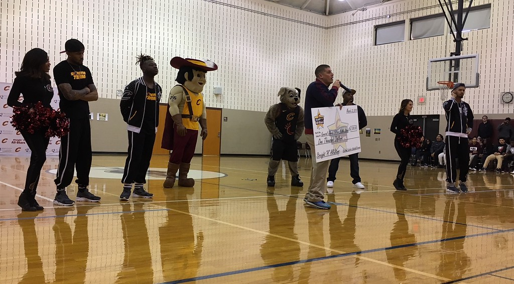 . Richard Payerchin - The Morning Journal <br> Bryan Hilko, principal of Lorain City Schools\' General Johnnie Wilson Middle School, talks to the crowd while carrying a $1,000 check on March 22, 2018. Cavs representatives visited the school to present a $1,000 check for the Cavs\' Straight �A� All-Stars program, presented by Westfield Insurance.