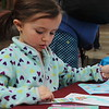 Kristi Garabrandt — The News-Herald <br> Gigi Kumel, 4, of Mentor selects stickers for the bookmarker she made during the Kidshow at Great Lakes Mall on March 24.
