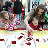 Kristi Garabrandt — The News-Herald <br> Danielle Mayse, 8, along with Angelique and Matthew Seese, 4, all of Mentor,  try their hands at the Game of Operation during the Kidshow at Great Lakes Mall on March 24.