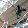 Kristi Garabrandt — The News-Herald <br> Payton Barnett,10, of Willowick does a flip while trying out the bungee jumping exhibit during the Kidshow at Great Lakes Mall on March 24.