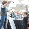 Kristi Garabrandt — The News-Herald <br> Kennedy Stallard, 4, of Eastlake does arm circles with an exhibitor from Cleveland Clinic to claim the prize she won after playing Plenco during the Kidshow at Great Lakes Mall on March 24.