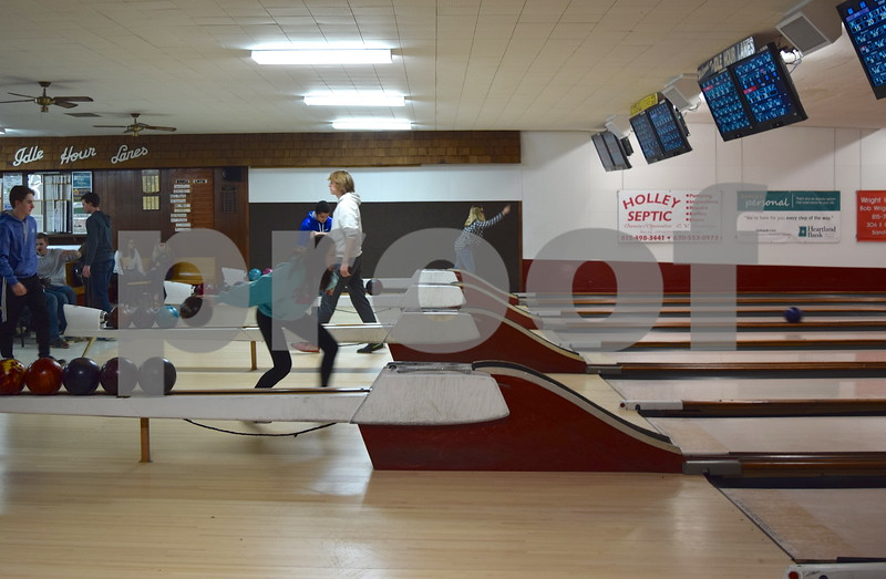Sandwich High School students bowl at Pinheadz at Idle Hour Lanes on March 14. Ron and Bonnie Miller, owners of Idle Hour Lanes for 41 years, sold the bowling alley to the Partridge family last month.
