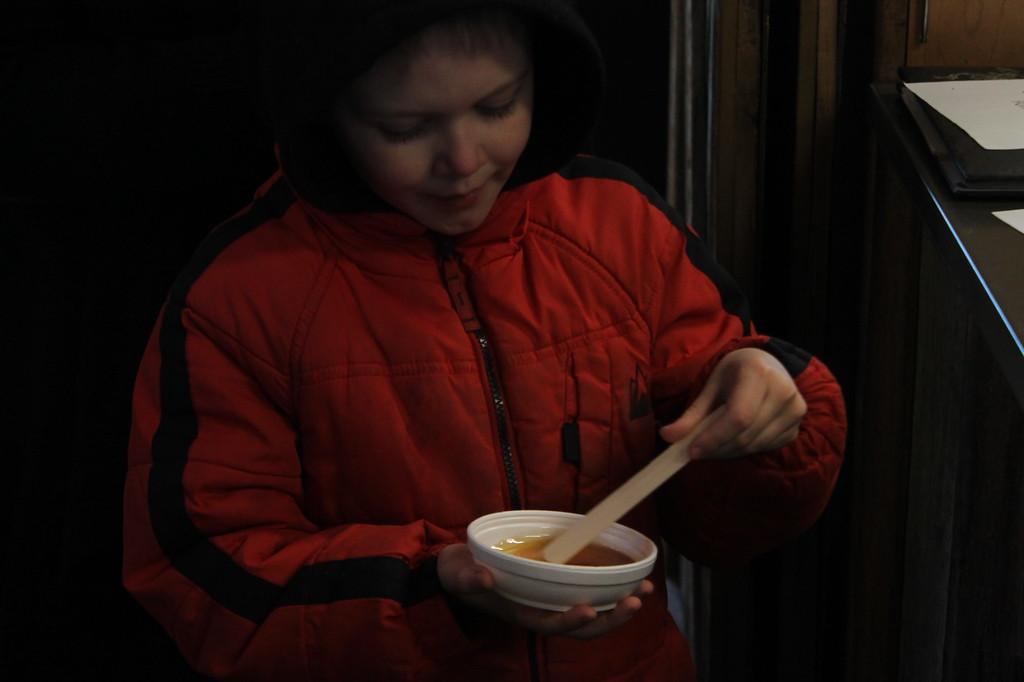 . Kristi Garabrandt - The News-Herald <br> Caleb Johnston, 7, of Chardon, attends the maple stirs each week with his family.