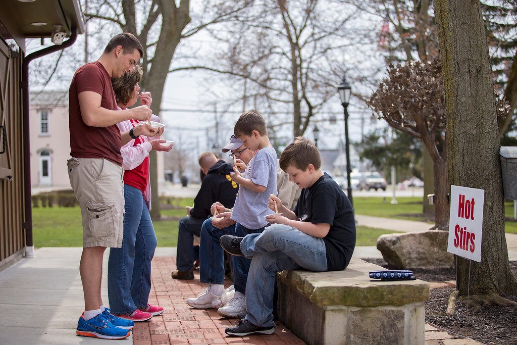 . Carrie Garland � The News-Herald <br> Families enjoy maple stirs on the Chardon Square on March 25, 2017.