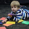 Michael, 3 spreads out the color cards that go with a story being read during the Special Needs Story Hour.<br /> Kristi Garabrandt - The News-Herald