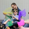 Grady,5, sits with his dad Aaron Glass and uses a scarf as a prop while listening to the story A Hat in the Wind, during Eastlake Public Library's Special Needs Story Hour.<br /> Kristi Garabrandt - The News-Herald