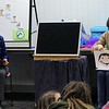 Children's librarian Samantha Nicholson reads to the children and her assistant Khin Myint holds up color cards coordinating to the story during the Special Needs Story Time at Eastlake Public Library.<br /> Kristi Garabrandt - The News-Herald
