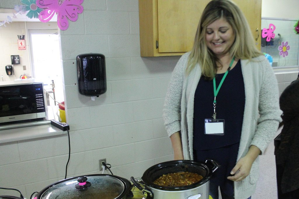 . First place winner in the Willoughby Branch Chili Cook Off , Ashley  Cuzzens stands with her chorizo chicken chili.  This was Cuzzens first time entering the event. Kristi Garabrandt  - The News-Herald