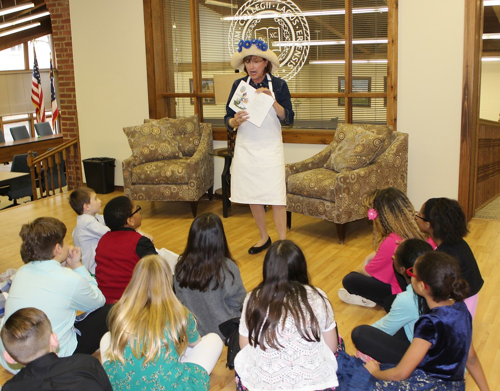 . Tawana Roberts - The News-Herald <br> Lake Erie College Director of Clinical Experiences and Partnerships Pam Martin read a book to Our Shepard Lutheran School students on March 28 for opening day of the scholastic book fair. Proceeds from the book fair will help Lake Erie College education students in EDE 308 Community Services give local children new books.