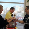Kristi Garabrandt — The News-Herald <br> Chick Fil-A Willoughby owner, Billie Federer, awards the trophy to Eastlake Mayor Dennis Morley after he was declared winner of the lemon squeeze competition.