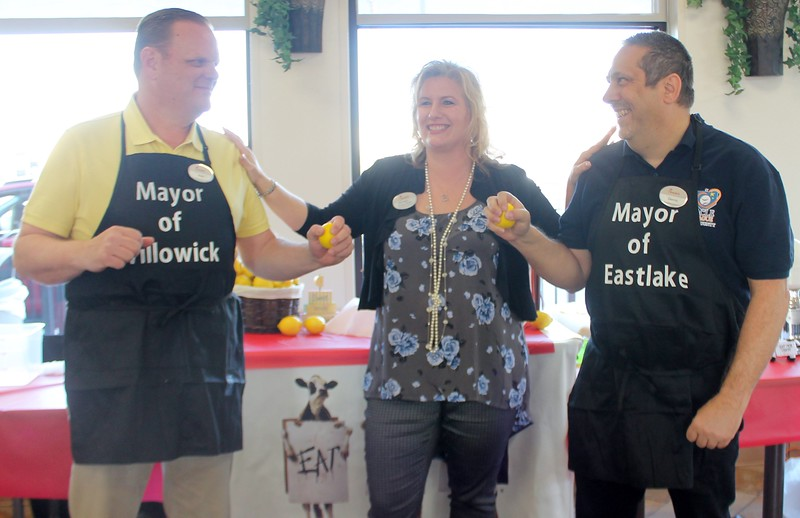 Kristi Garabrandt — The News-Herald <br> Chick-Fil-A Willoughby owner, Billie Federer stands with Willowick Mayor Rich Regovich and Eastlake Mayor Dennis Morley as they prepare to battle it out in the first annual lemon squeeze competition at Chick-Fil-A Willoughby.