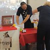 Kristi Garabrandt — The News-Herald <br> Eastlake Mayor Dennis Morley comes from behind to win the Lemon Squeeze battle after Miracle League Director assists by transferring the lemon juice from Willowick Mayor Rich Regovich's bucket to Morleys.
