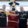 Kristi Garabrandt — The News-Herald <br> Chick-Fil-A mascot, The Cow, stands with Willowick Mayor Rich Regovich and Eastlake Mayor Dennis Morley as they prepare to battle it out in the first annual lemon squeeze competition at Chick-Fil-A Willoughby.