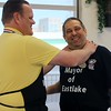 Kristi Garabrandt — The News-Herald <br> Willowick Mayor Rich Regovich playfully puts the squeeze on Eastlake Mayor Dennis Morley after Morley was declared the winner of the Lemon Squeeze Battle to benefit Miracle League of Lake County at Chick-Fil-A Willoughby.