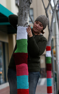 TREES DECORATED WTH HAND KNIT SWEATERS