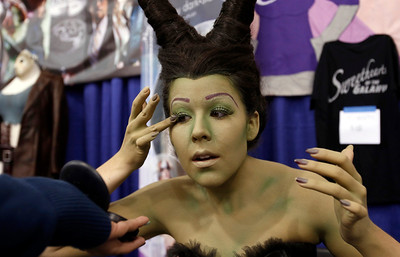 Kit Quinn, a cosplayer from San Ramon, adjusts her eyelashes as she gets into character at the Big Wow Comic Festival at the San Jose Convention Center in San Jose, Calif., on Sunday, May 18, 2014. (Karl Mondon/Bay Area News Group)