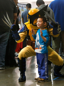 Dustin Tat, 5, of San Jose poses with the wolverine played by William Zavala of Berkeley at the Big Wow Comic Festival came at the San Jose Convention Center in San Jose, Calif., on Sunday, May 18, 2014. (Karl Mondon/Bay Area News Group)