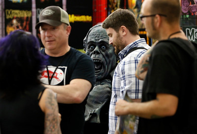 Visitors to the Big Wow Comic Festival walk past an over-sized Lon Chaney sculpture at the San Jose Convention Center in San Jose, Calif., on Sunday, May 18, 2014. (Karl Mondon/Bay Area News Group)