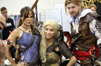 Cosplayers Rose May as Lara Croft, Sam Skyler as Mother of Dragons and Alex Vitelli as Assasin's Creed Edward, pose at the Big Wow Comic Festival at the San Jose Convention Center in San Jose, Calif., on Sunday, May 18, 2014. (Karl Mondon/Bay Area News Group)