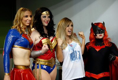 Famed cosplay model Jessice Nigri, second from left, poses for a picture with a group of female super heroes at the Big Wow Comic Festival came at the San Jose Convention Center in San Jose, Calif., on Sunday, May 18, 2014. (Karl Mondon/Bay Area News Group)