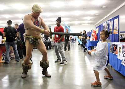 Hannah Paquiz, 5, in her Princess Leia outfit in not intimidated by He-Man played by Matt Helm of San Jose at the Big Wow Comic Festival at the San Jose Convention Center in San Jose, Calif., on Sunday, May 18, 2014. (Karl Mondon/Bay Area News Group)