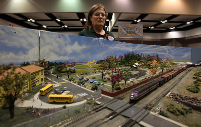 Michele Witten keeps on eye on her handmade landscape, part of the Peninsula NTrak display at the Toy & Model Train Expo at the Santa Clara Convention Center, Saturday morning, March 1, 2014, in Santa Clara, Calif. (Karl Mondon/Bay Area News Group)