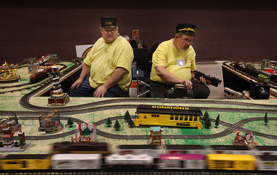 Gene Edwardson and Ron Jeske, both from Modesto and with the San Joaquin Valley Toy Train Operators, monitor their rail traffic at the Toy & Model Train Expo at the Santa Clara Convention Center, Saturday morning, March 1, 2014, in Santa Clara, Calif. (Karl Mondon/Bay Area News Group)