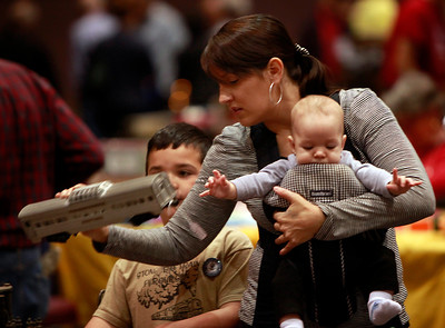 """Heather Ferguson, of Union City, browses with her boys Stone, 6, and Timber, 3 months, at the Toy & Model Train Expo at the Santa Clara Convention Center, Saturday morning, March 1, 2014, in Santa Clara, Calif. Stone's nickname is """"Big Train"""". (Karl Mondon/Bay Area News Group)"""