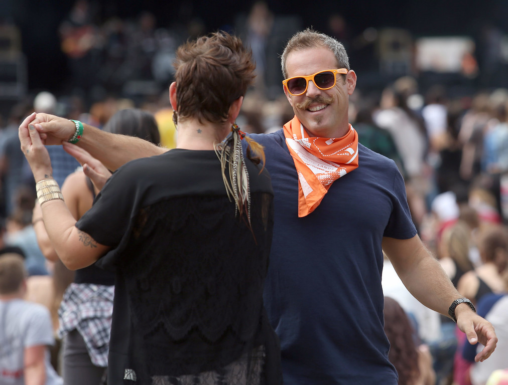 . Bryan Rorie, right, and girlfriend Rachel Jordan, of Davis, dance near the Land\'s End stage during day three of the Outside Lands music festival at Golden Gate Park in San Francisco, Calif., on Sunday, Aug. 10, 2014. (Jane Tyska/Bay Area News Group)