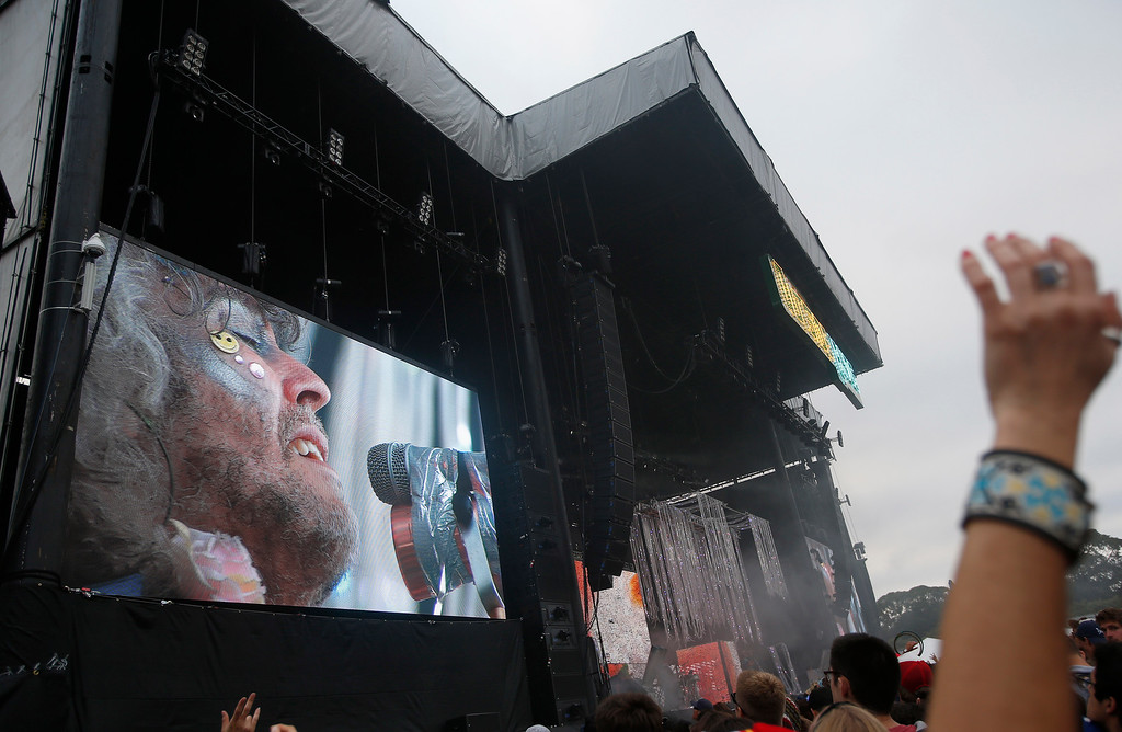 . The Flaming Lips lead singer Wayne Coyne is seen in a video monitor as they perform on the Land\'s End stage during day three of the Outside Lands music festival at Golden Gate Park in San Francisco, Calif., on Sunday, Aug. 10, 2014. (Jane Tyska/Bay Area News Group)