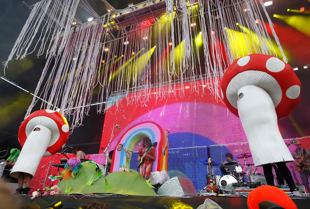 . The Flaming Lips, featuring lead singer Wayne Coyne, center, perform on the Land\'s End stage during day three of the Outside Lands music festival at Golden Gate Park in San Francisco, Calif., on Sunday, Aug. 10, 2014. (Jane Tyska/Bay Area News Group)