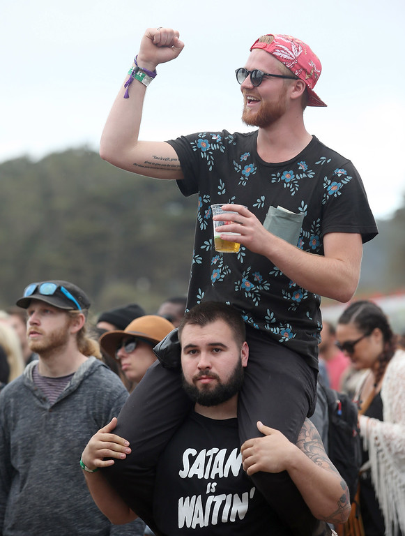 . Zach Norgberg, of Los Angeles, below, and Robert Hansen,  of San Francisco, listen to The Flaming Lips at the Land\'s End stage during the last day of the Outside Lands music festival at Golden Gate Park in San Francisco, Calif., on Sunday, Aug. 10, 2014. (Jane Tyska/Bay Area News Group)